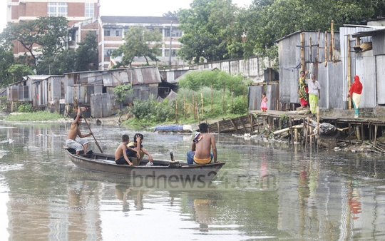 Boat becomes the only means of travel for when the Baganbari canal overflows after rain. Photo: Asif Mahmud Ove