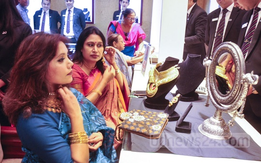 Women visit a shop at the three-day long gold fair held in Dhaka's Hotel InterContinental on Sunday.