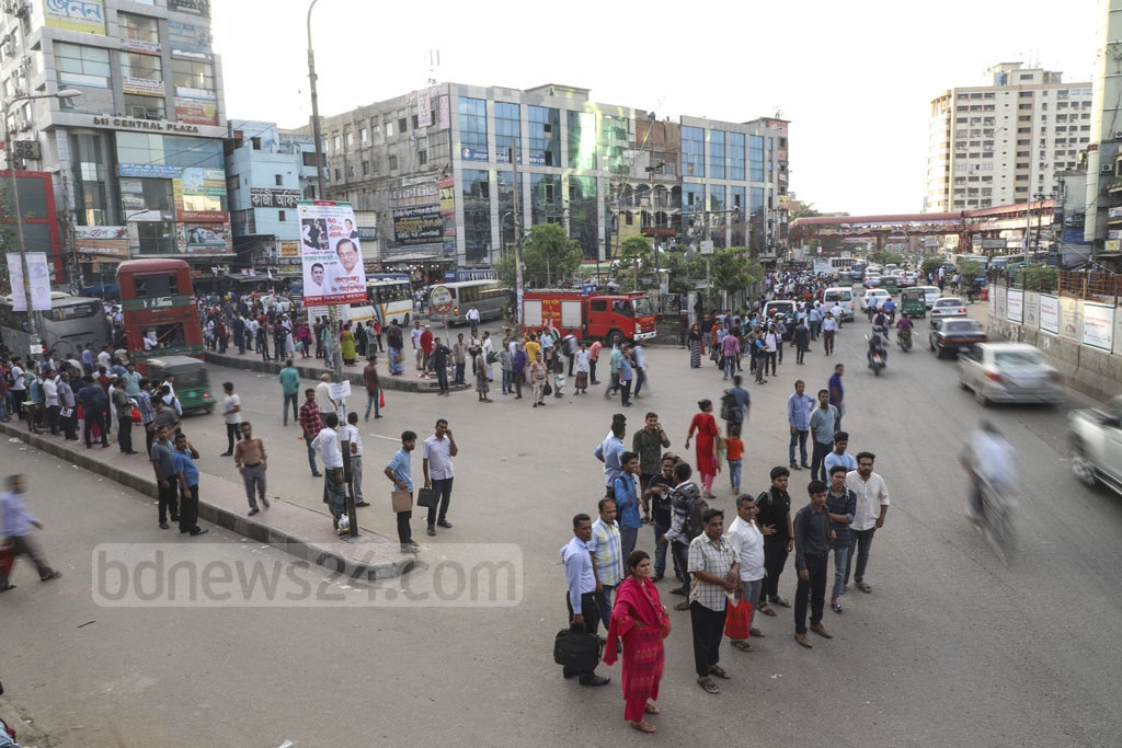 A lack of public transport made commuters in Dhaka's Farmgate to wait for hours to get back home after work on Sunday. Photo: Abdullah Al Momin
