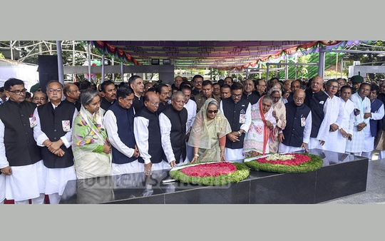 Prime Minister Sheikh Hasina places a wreath with other party leaders in front of Bangabandhu Sheikh Mujibur Rahman's portrait on the 70th anniversary of the party's inception on Sunday.