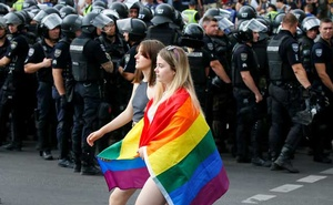 Police officers guard participants of the Equality March, organised by the LGBT community, in Kiev, Ukraine Jun 23, 2019. REUTERS