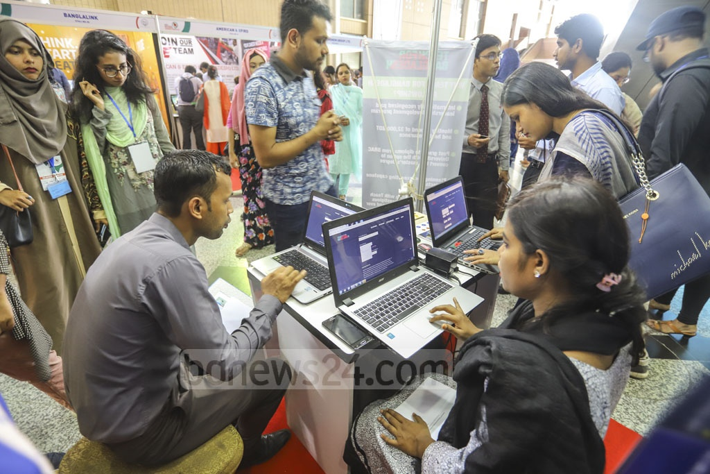 Job-seekers register their names at a stall of the career fair at the Bangabandhu International Conference Centre on Thursday. Photo: Asif Mahmud Ove