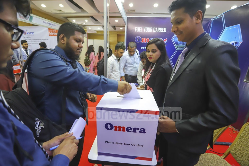 A job-seeker submits a job application at a stall of the career fair at the Bangabandhu International Conference Centre. Photo: Asif Mahmud Ove