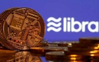 FILE PHOTO: Representations of virtual currency are displayed in front of the Libra logo in this illustration picture, June 21, 2019. REUTERS
