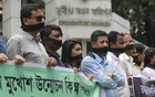 "Journalists wrapped their mouths in black cloths to protest in front of the Anti-Corruption Commission headquarters in Dhaka on Sunday against what they say is 'offensively worded"" letters to summon two journalists as part of an investigation."