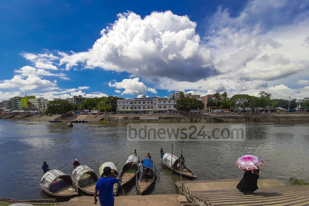 White clouds hover beneath a clear blue sky amid the monsoon season. The photo was taken in Tongi's Turag River on Monday.