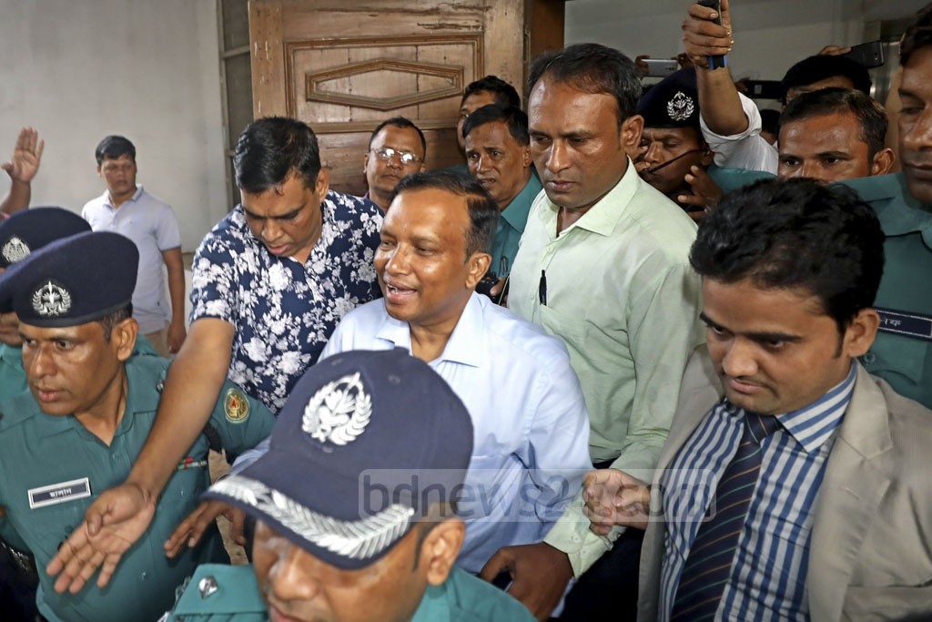 Suspended DIG Mizanur Rahman being taken into police custody after the High Court denied him bail in a graft case over illegally amassed wealth.