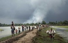 FILE -- Rohingya refugees press on after crossing the Naf River, as villages in Myanmar burned in the distance, near Palong Khali, Bangladesh, Sept. 4, 2017. The release of two journalists after 16 months in prison does not otherwise move the needle for freedom of expression and other rights that are in jeopardy in Myanmar, analysts and activists said. (Adam Dean/The New York Times)