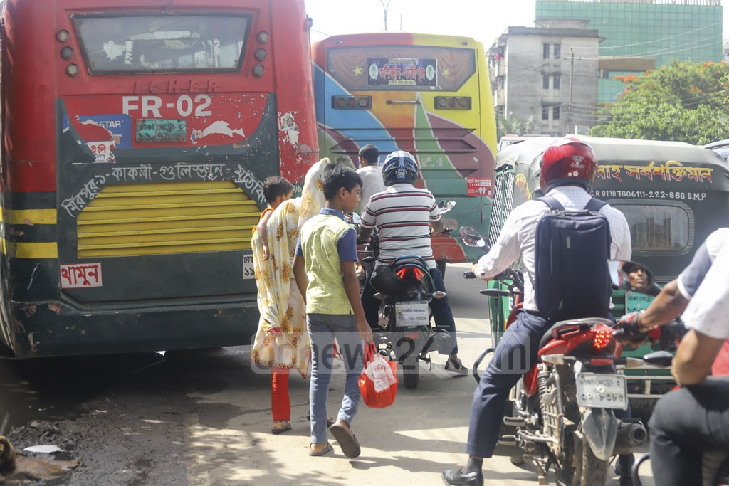 Buses parked haphazardly on the street opposite to Mohakhali Bus Terminal in Dhaka, leaving no place for pedestrians to walk on a stretch where there should be a pavement. Photo: Asif Mahmud Ove