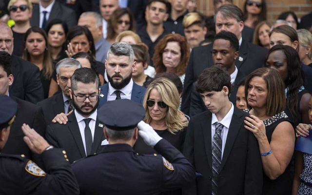 Police officers salute the family of Luis Alvarez, a former New York detective who became a champion of the emergency workers who had responded to the Sep 11, 2001, terrorist attacks, at his funeral outside the Immaculate Conception Church in New York, Jul 3, 2019. The New York Times