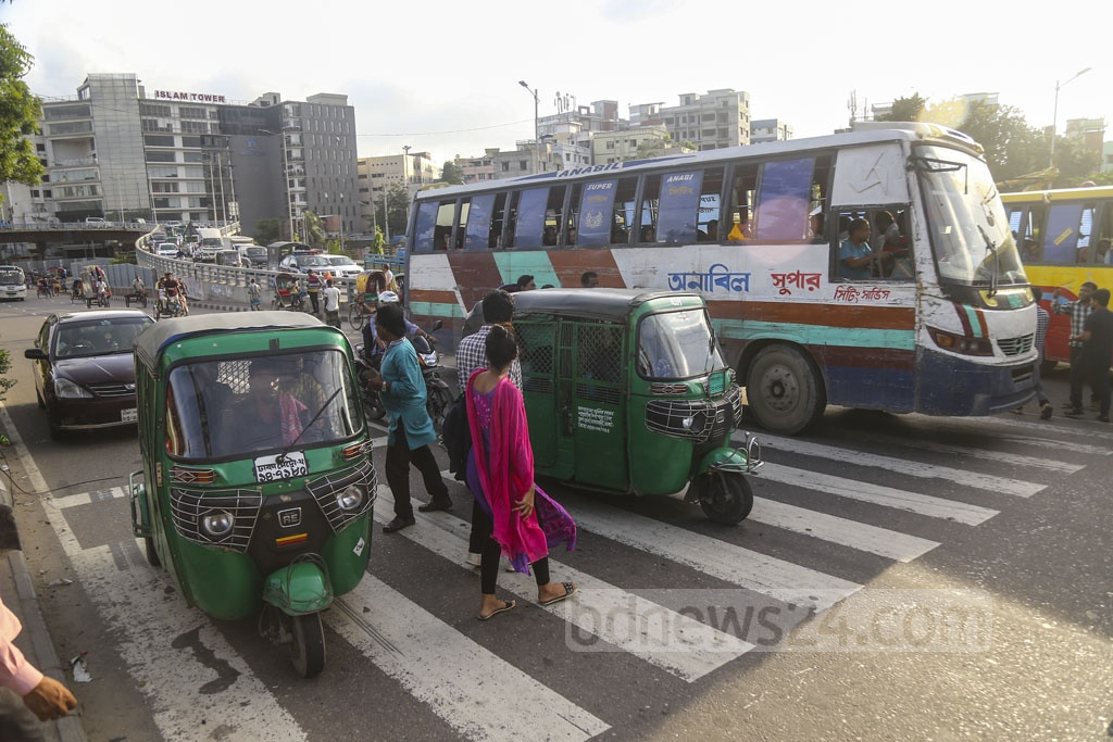Drivers do not stop vehicles at a zebra crossing even when pedestrians cross the street at the U-loop in Dhaka's Rampura, leading to road accidents almost daily. This photo was taken on Friday. Photo: Mahmud Zaman Ovi