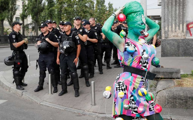 File Photo: Police officers guard participants of the Equality March, organized by the LGBT community, in Kiev, Ukraine Jun 23, 2019. REUTERS