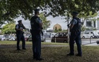 FILE -- Police officers near the Al Noor Mosque in the days after it was attacked in Christchurch, New Zealand, March 17, 2019. The footage, games, memes and messages that glorify the Christchurch massacre and still populate the dark corners of the global internet underline the immensity of the task of fighting online hate, especially for a small country like New Zealand. (Adam Dean/The New York Times)