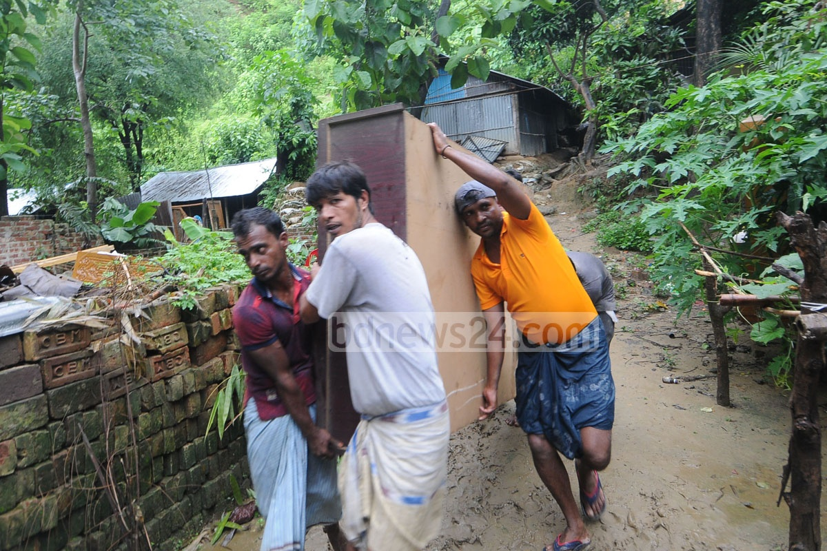 The Chattogram district authorities conducted an eviction drive on Sunday in which they demolished illegal hillside structures to move away residents who risk being hit by landslides after rains.