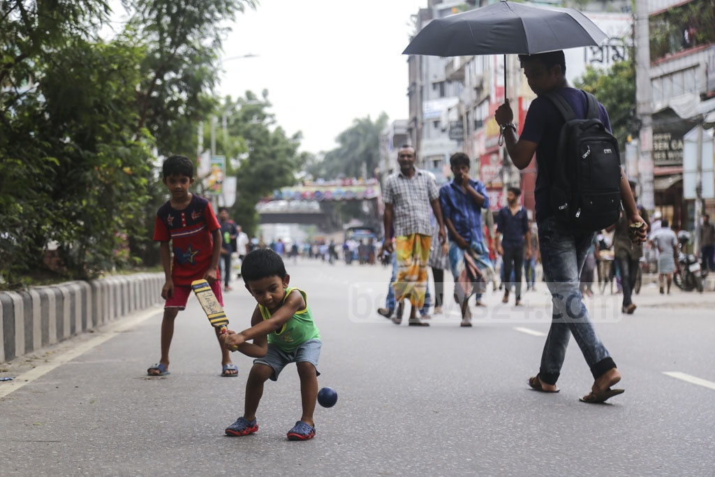 A child playing with a ball on the Rampura DIT road during a protest called by rickshaw-pullers. Photo: Mahmud Zaman Ovi