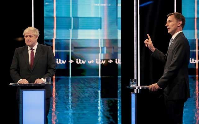 Boris Johnson and Jeremy Hunt, leadership candidates for Britain's Conservative Party, attend Britain's Next Prime Minister: The ITV Debate at MediaCityUK in Salford, Britain July 9, 2019. Matt Frost/ITV/Handout via REUTERS