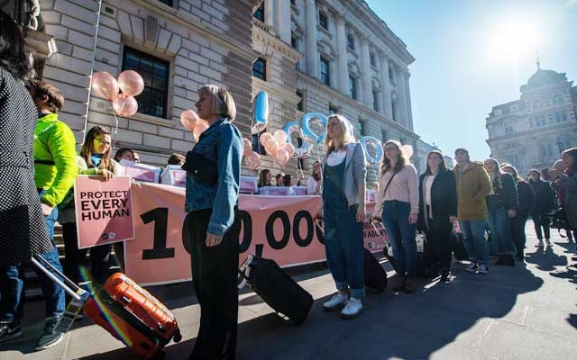 Protesters calling for a change in Northern Ireland's abortion law walking near Parliament in London. The New York Times