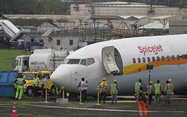 A SpiceJet Boeing 737-800 airplane is seen after it overshot the runway while landing due to heavy rains at an airport in Mumbai, India Jul 2, 2019. REUTERS