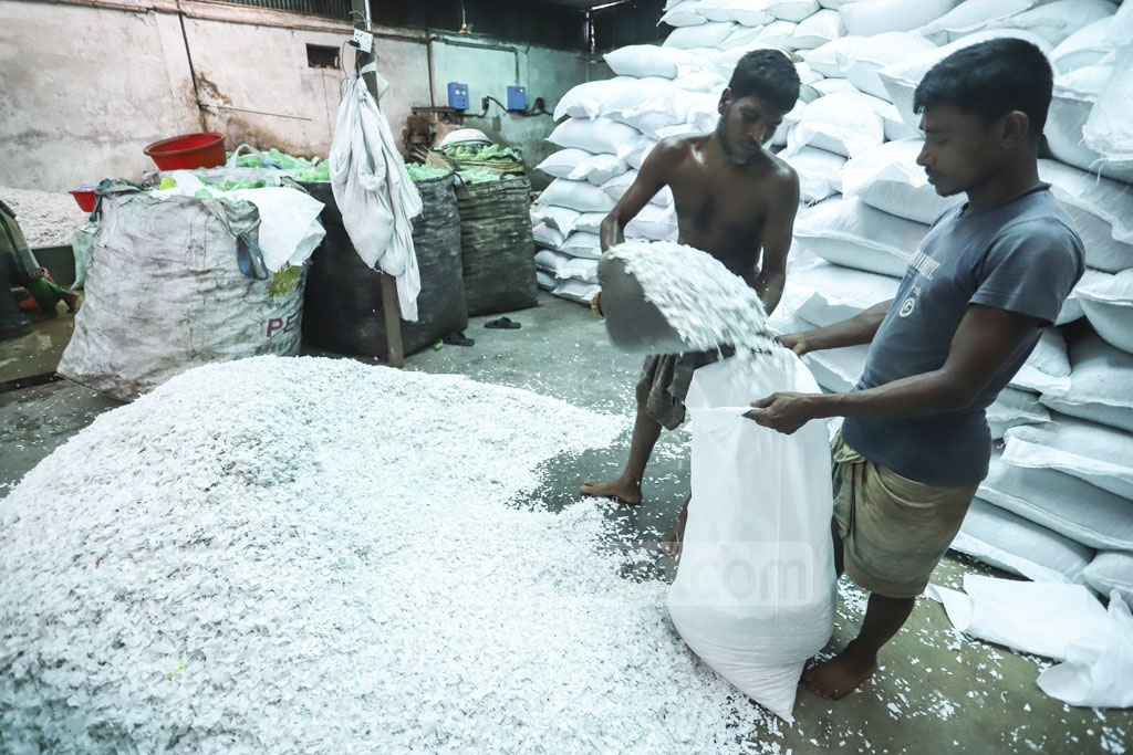 After drying up, the plastic pieces are placed in sacks for exports. Photo: Asif Mahmud Ove