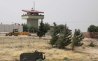 FILE PHOTO: Turkish soldiers stand on a watch tower at the Atmeh crossing on the Syrian-Turkish border, as seen from the Syrian side, in Idlib governorate, Syria May 31, 2019. REUTERS