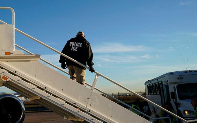 An Immigration and Customs Enforcement agent as deportations were being carried out in November in Houston. The New York Times