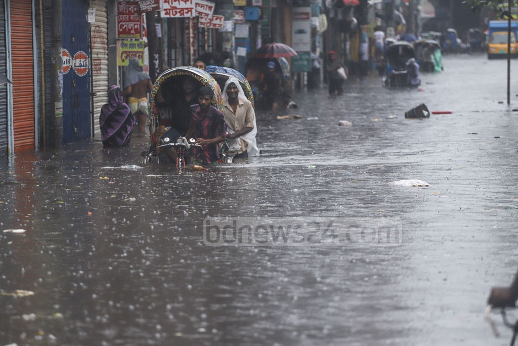 The streets outside Sayedabad Bus Terminal in Dhaka went under water after incessant rain on Friday, spelling huge trouble for the people. Photo: Abdullah Al Momin
