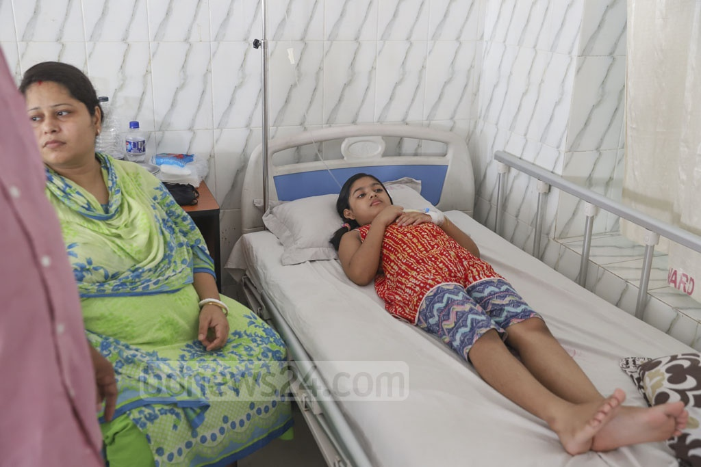 Children suffering from dengue at the Holy Family Hospital in Dhaka on Saturday. Photo: Abdullah Al Momin