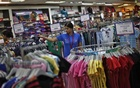 Representational Image: A sales assistant arranges clothing inside a retail store in New Delhi April 6, 2013. Reuters