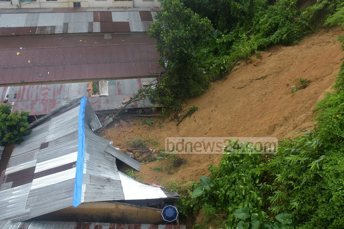 Landslide amid incessant rain causes much damage at Lalkhan Bazar in the port city's Kusumbagh residential area on Saturday.