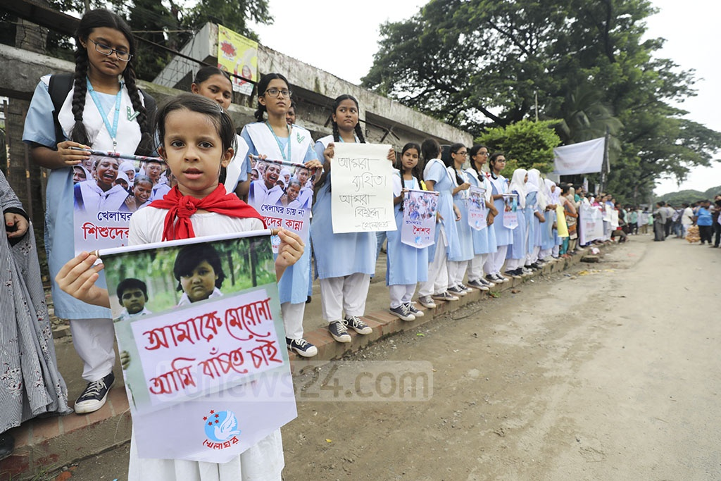 Activists from several organisations forming a human chain in front of the national press club in Dhaka on Saturday in protest of the nationwide oppression and murder of children.