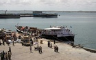FILE PHOTO: Workers stand at the sea port of the coastal town of Kismayu in southern Somalia Nov 12, 2013. REUTERS