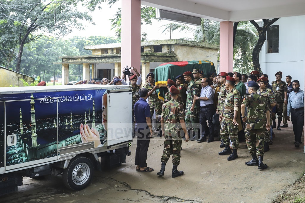 The coffin of Jatiya Party Chairman HM Ershad is being taken to the Army Central Mosque from Combined Military Hospital in Dhaka for funeral prayers on Sunday. Photo: Asif Mahmud Ove