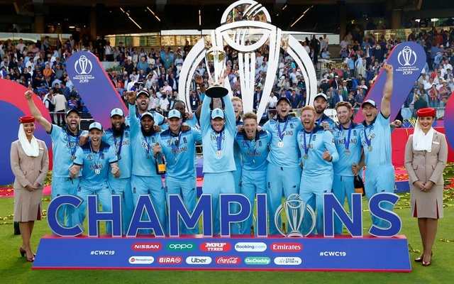 ICC Cricket World Cup Final - New Zealand v England - Lord's, London, Britain - July 14, 2019 England's Eoin Morgan and teammates celebrate winning the World Cup with the trophy Action Images via Reuters