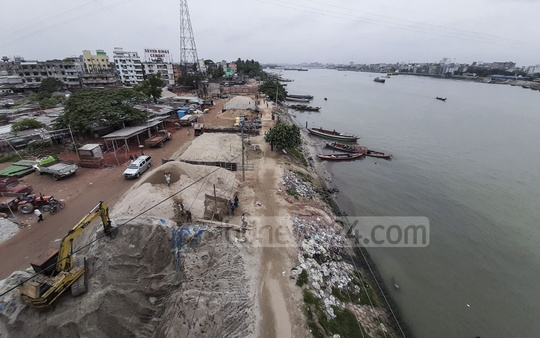 Sand and boulder businesses occupying the banks of the Buriganga River in Keraniganj's Hasnabad area.