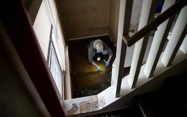 A water sample is collected in a flooded home, work that was performed in the aftermath of Hurricane Harvey by both researchers and municipal health officials, in Houston, Texas, Sep 5, 2017. The New York Times