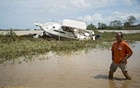 A man walks through floodwaters in the aftermath of Hurricane Maria in Toa Baja, Puerto Rico, Sep 22, 2017. New research shows that the extreme weather and fires of recent years, similar to the flooding that has struck Louisiana and the Midwest, may be making Americans sick in ways researchers are only beginning to understand. The New York Times
