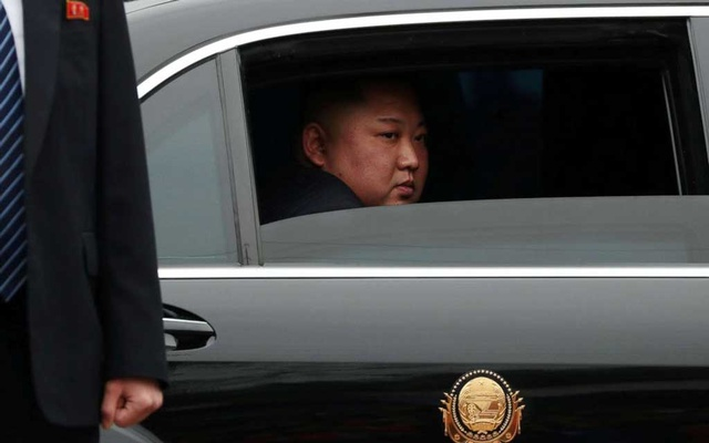 FILE PHOTO: North Koreas leader Kim Jong Un sits in his vehicle after arriving at the Athit Perawongmetha. Reuters