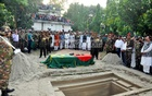 The coffin of HM Ershad lies next to the grave before burial at the litchi orchard in his Rangpur home on Tuesday.