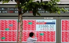 Asian shares inch up as cautious investors await US data, earnings