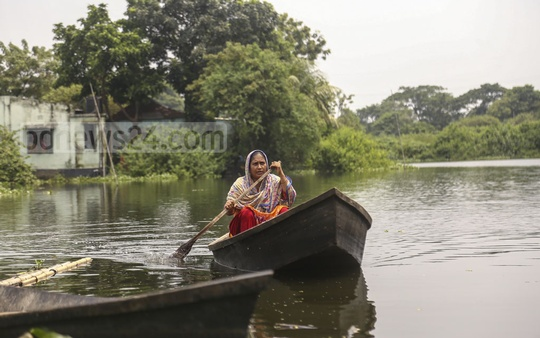 The level of water in several low-lying parts of Dhaka has begun to rise after torrential rains for days, leaving residents of many areas like Newazbagh in Nandipara stranded. Boat is now their only means of transport. Photo: Mahmud Zaman Ovi