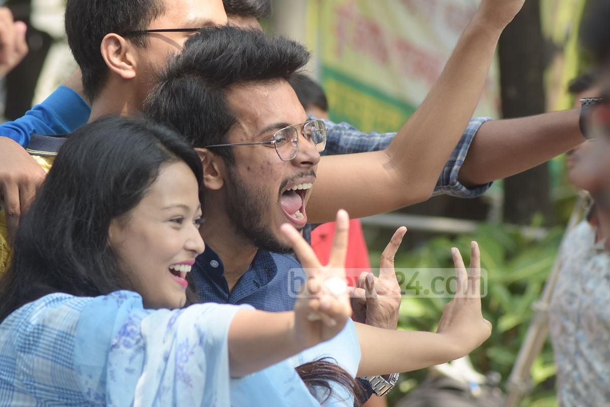 Chittagong College students, who have achieved a GPA of 5.0 in HSC examinations, celebrate after the publication of the results on Wednesday. Photo: Suman Babu