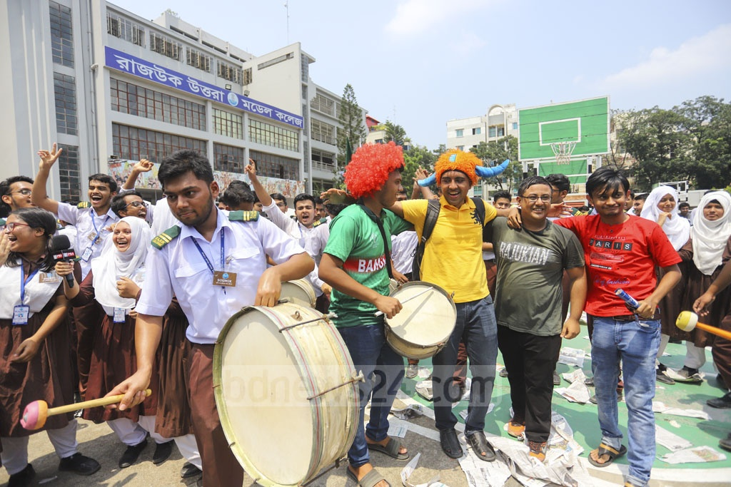 Rajuk Uttara Model College students in Dhaka celebrating with the beats of drums their success in the HSC and equivalent examinations on Wednesday. Photo: Asif Mahmud Ove