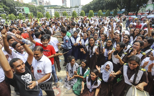 Rajuk Uttara Model College students celebrating their success in HSC exams after the publication of the results on Wednesday. Photo: Asif Mahmud Ove