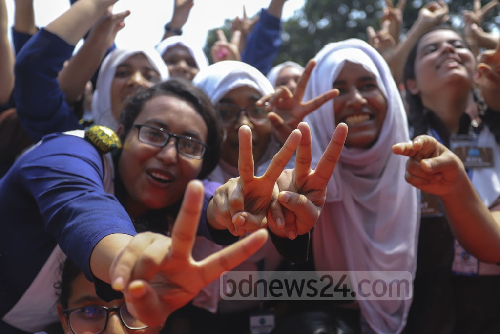 Rajuk Uttara Model College students in Dhaka flashing the V-sign to celebrate success with the beats of drums after the publication of results of HSC and equivalent exams on Wednesday. Photo: Asif Mahmud Ove