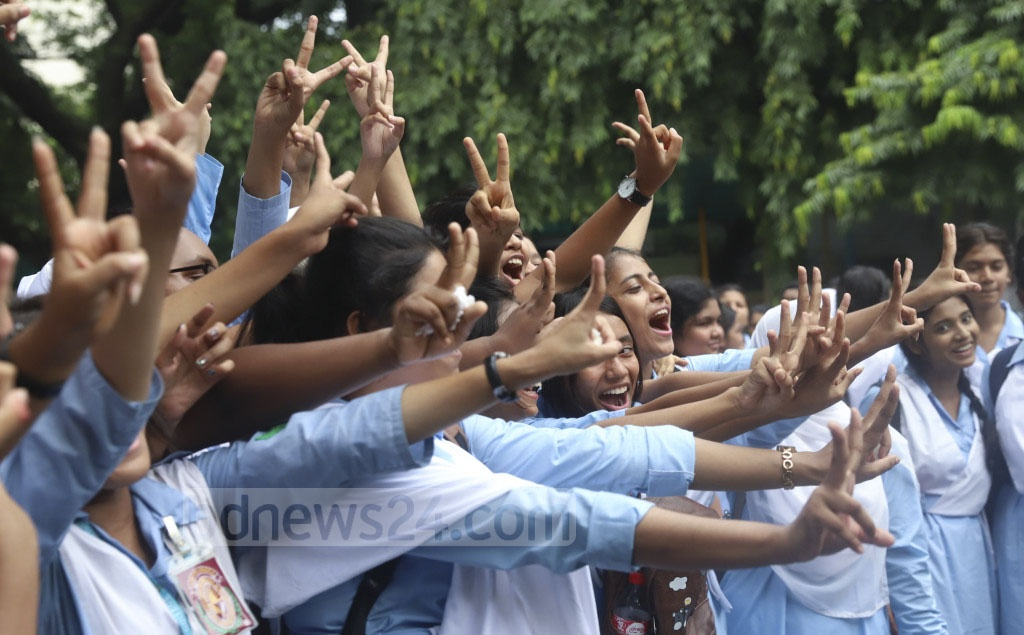 Students of Viqarunnisa Noon School and College, overjoyed at their success in HSC exams, flash the V-sign after the publication of the results on Wednesday. Photo: Abdullah Al Momin