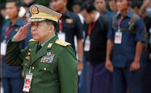 FILE PHOTO: Myanmar's Commander in Chief Senior General Min Aung Hlaing salutes as he attends an event marking Martyrs' Day at Martyrs' Mausoleum in Yangon, Myanmar Jul 19, 2018. REUTERS/Ann Wang/File Photo