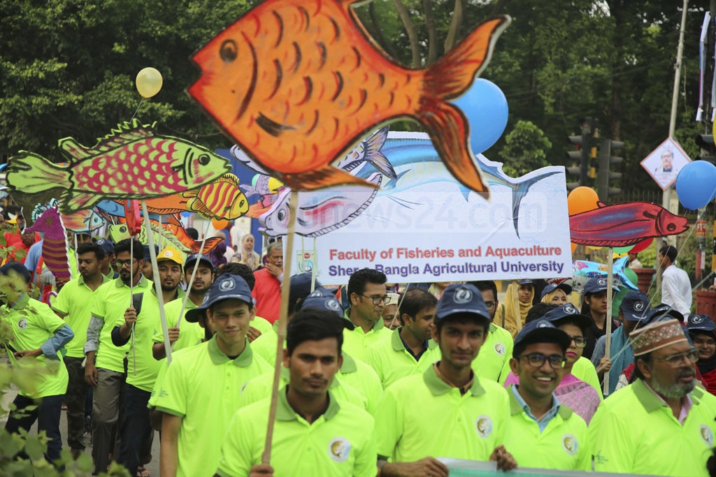 The fisheries and livestock ministry took out a procession carrying lifesize images of fish crafted from boards to celebrate National Fisheries Week 2019 in Dhaka on Wednesday.