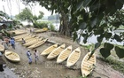 A boat market for people of the low-lying areas of Dhaka sits every Thursday during monsoon on the bank of the Balu river at Kayetpara Bazar in Nasirabad. Photo: Asif Mahmud Ove