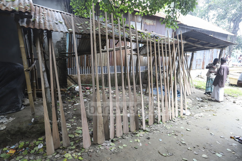 Oars are on display at a weekly boat market on the bank of the Balu river in Dhaka's Nasirabad. Photo: Asif Mahmud Ove