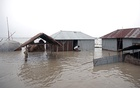 FILE PHOTO: Houses are seen flooded in Kurigram, Bangladesh, July 15, 2019. REUTERS